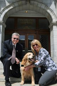 Helpers with Rose, a dog who helps troubled children, outside a New York courthouse where the dog appeared last month.