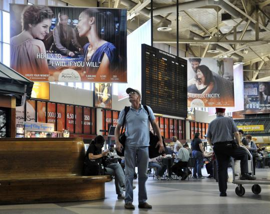 Mohegan Sun's array of ads in South Station is an example of how single companies have blanketed transit stations with banners and signs.