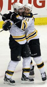 Patrice Bergeron (left) and Gregory Campbell celebrate Bergeron's second goal.