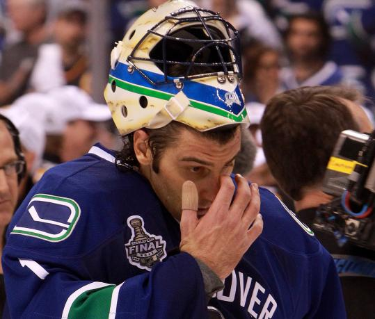 Roberto Luongo had his ups and downs in the series, the biggest downer coming as he leaves the ice after Game 7.