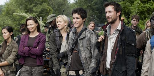 "From left: Seychelle Gabriel, Moon Bloodgood, Jessy Schram, Drew Roy, and Noah Wyle star as resistance fighters against aliens in the TNT series ""Falling Skies.''"