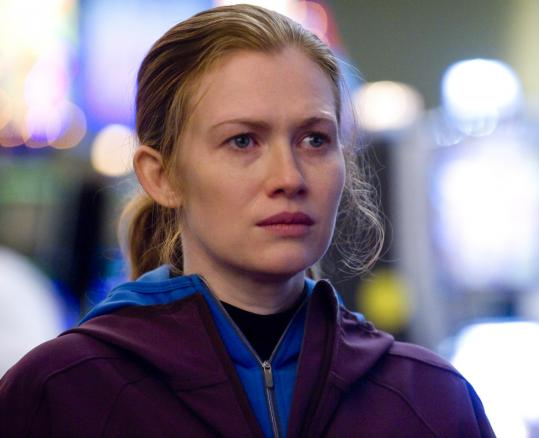 Mireille Enos hauntingly portrays detective Sarah Linden, who obsessively tracks Rosie Larsen&#8217;s killer in the AMC drama.