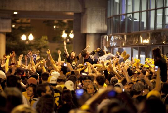 Fans celebrated in relative peace in Boston after the Bruins won the Stanley Cup. Five arrests and no serious injuries were reported.