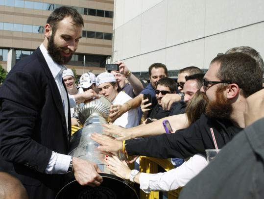 Bruins faithful greeted captain Zdeno Chara (left) and the long-awaited Stanley Cup at TD Garden yesterday.