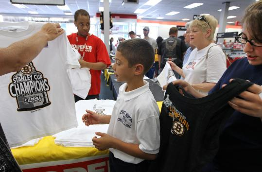 Antonio Gerardi, 10, and sister Dariana, 11, looked at Bruins shirts at Modell's Sporting Goods in Medford. The gear was hot everywhere.