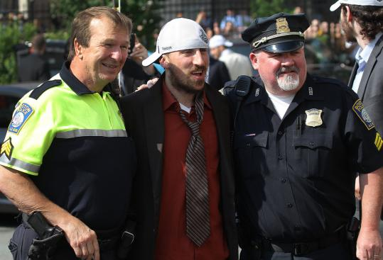 About the only thing that can stop Bruins spark plug Brad Marchand (center) in his tracks is a couple of Boston Police officers.