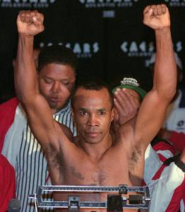 """Sugar Ray Leonard weighing before his fight with Hector """"Macho'' Camacho in 1997."""