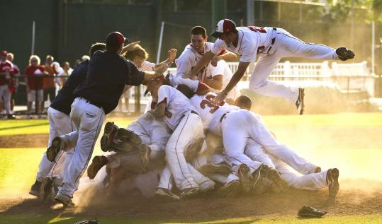 Following the final out of their 10-2 championship-game win, Lincoln-Sudbury players form a victory pile at Fraser Field in Lynn.