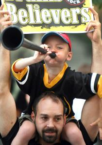 Alex Merloni, 5, from North Grafton celebrated loudly with his father, Gregg, as the Bruins' rolling rally moved along Boylston Street yesterday.