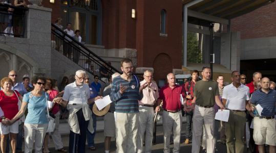"St. Cecilia parishioners prayed outside their Catholic church on Belvidere Street in Boston yesterday at a service with the theme ""All Are Welcome.''"