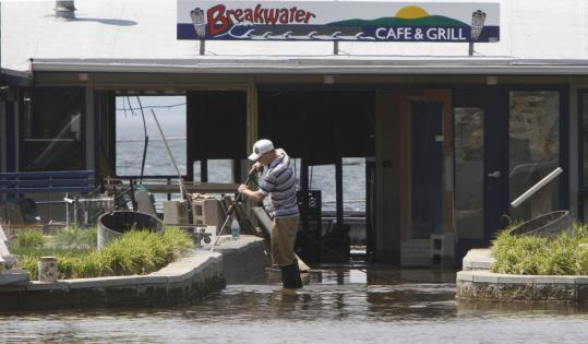 Businesses along Lake Champlain's shoreline in Burlington, Vt., began cleanup efforts over the weekend after the lake dipped below its flood stage for the first time since April 13.