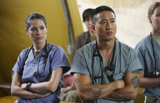 Michelle Borth (left) and Terry Chen star as young medics assigned to duty at a hospital in Kandahar, Afghanistan.