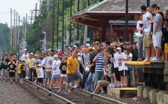 An overflow crowd of Bruins fans awaited an approaching train at the Reading commuter rail station Saturday morning.