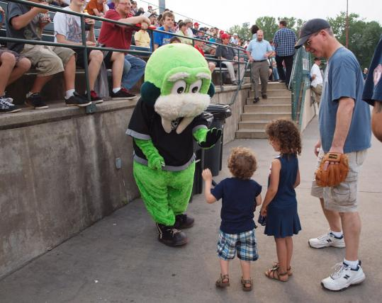 A Rock Cats mascot welcomes fans to New Britain Stadium.