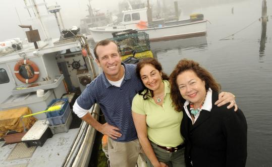 Joey Ciaramitaro of Captain Joe and Sons with Jacqueline Ganim-DeFalco (center) and Kristine Fisher, both of seARTS.