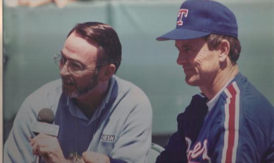 A bearded Larason interviews the Rangers' Nolan Ryan in 1992.