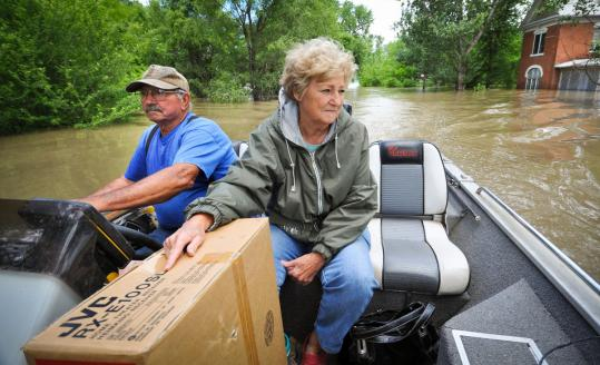 Jerry and Mary Murr took a boat to their home yesterday in Corning, Mo. Water from the Missouri River has covered the town.