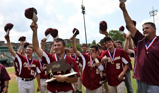 Ryan O'Connor holds the trophy as Newburyport High players celebrate their Division 3 state championship win.