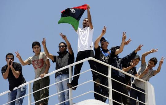 "One of the freed Libyan rebels aboard a Red Cross ship yesterday said security forces ""broke my ribs, hand, and leg.''"