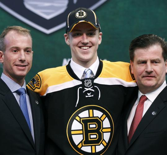 It didn't take long for 18-year-old defenseman Dougie Hamilton to feel comfortable as the newest member of the Bruins.
