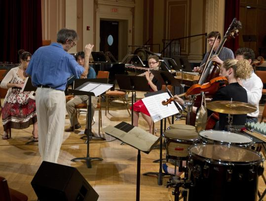 "Stephen Drury conducts six players in French new music composer Tristan Murail's ""Lachrymae'' at Brown Hall at the New England Conservatory Saturday. Murail is in residence at the Summer Institute for Contemporary Performance Practice."