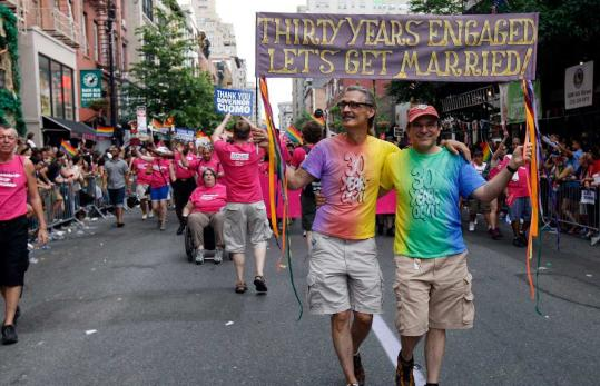 Governor Andrew Cuomo was the star of yesterday's gay-pride parade in New York City, which became a joyful celebration of last week's state Senate vote to legalize same-sex marriage. Longtime couple Richard Proust (left) and Donald Corren announced their intentions as they marched.