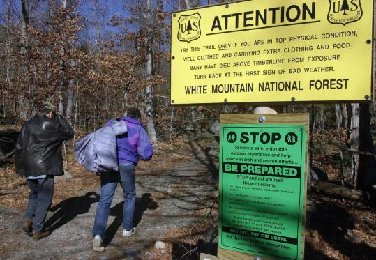 A pair of seemingly unprepared hikers started up Mount Washington's Tuckerman Ravine Trail, past warning signs.