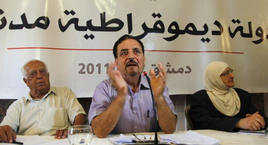 Shawki Baghdadi, Munther Khaddam, and Hanan Laham (left to right) led a session of opposition leaders yesterday.