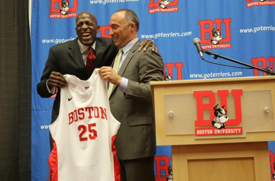 New Boston University men's basketball coach Joe Jones (left) shares a laugh with athletic director Mike Lynch.