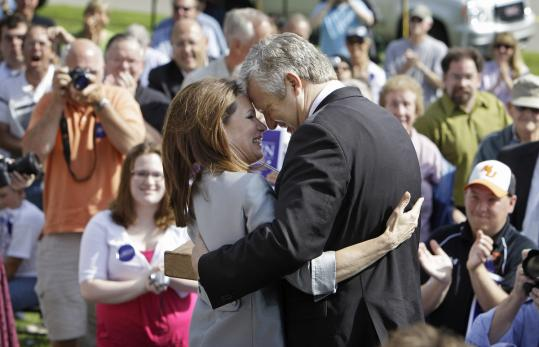Representative Michele Bachmann hugged her husband, Marcus, after her announcement in her hometown of Waterloo, Iowa.