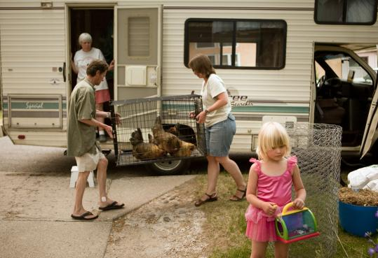 A Los Alamos family prepared to flee yesterday because of a wildfire that had grown to more than 68 acres overnight.