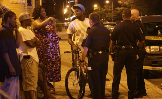 Officers questioned community members about a shooting at Talbot Avenue and Wales Street in Dorchester. They were looking for two young men who may have fled on motorized dirt bikes.