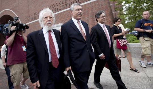 From left, defense lawyers Jonathan Shapiro, Max Stern, and Howard Cooper leaving the federal courthouse yesterday.