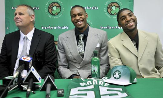 Celtics president Danny Ainge began his youth movement by drafting JaJuan Johnson (center) and E'Twaun Moore, both of whom played four years at Purdue.