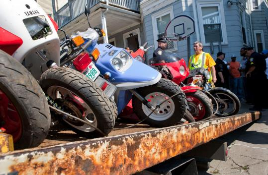 Boston police confiscated a number of motorbikes at a Mattapan residence yesterday as part of a crackdown after the shooting of a boy in a city park.