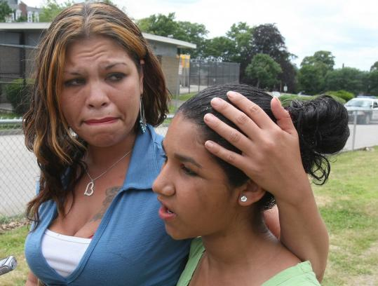 "Elba Saldivar-Cruz, standing with her daughter, talked about the death of her friend Marie Joseph in Fall River yesterday. ""She lost her brother and some other family members in the earthquake in Haiti, and now this happens,'' Saldivar-Cruz said."