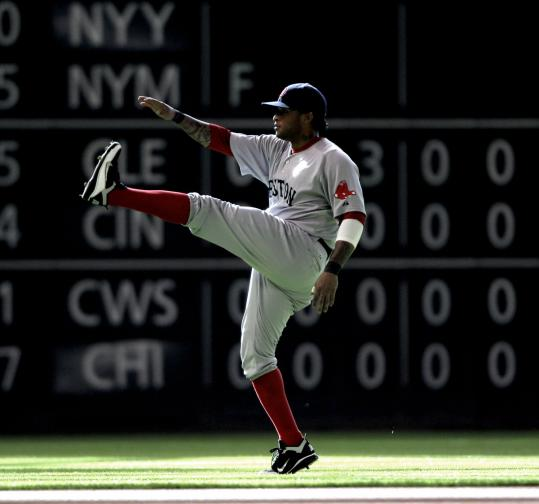 Outfielder Darnell McDonald gets in some stretching before the Red Sox took on the Astros in the middle game of the three-game series in Houston.