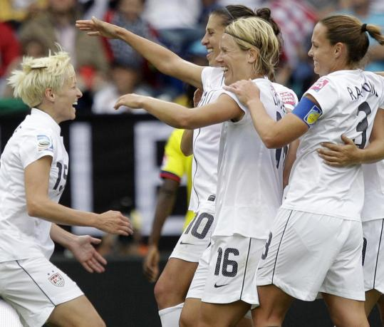 Megan Rapinoe (left) celebrates with her teammates after scoring for the US, which advanced to the quarterfinals.