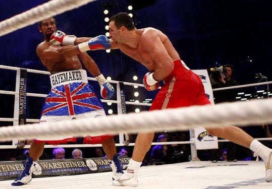 Vladimir Klitschko (right) earned the WBA heavyweight title with a unanimous decision over champion David Haye.