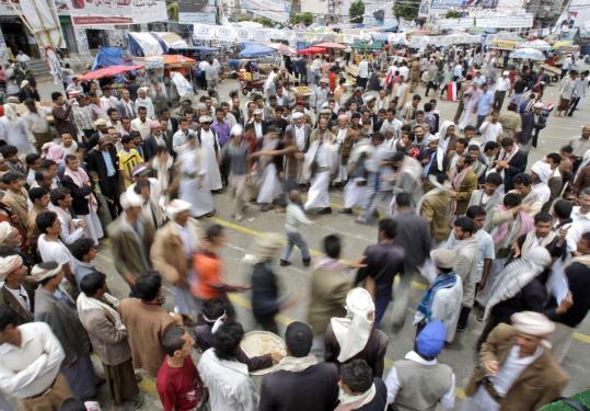 PRESSURE IN YEMEN — Protestors danced during a demonstration demanding the resignation of President Ali Abdullah Saleh, in Sana, Yemen, yesterday.