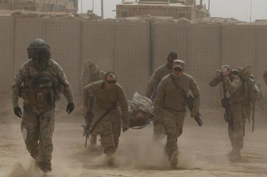 US Army soldiers evacuated a comrade who was injured by an improvised explosive device yesterday in Afghanistan.