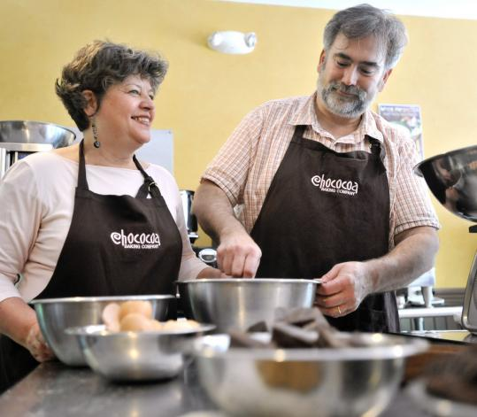 Julie Ganong and Alan Mons work on a batch of whoopie pies at Chococoa in Newburyport.