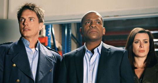 "From left: John Barrowman, Mekhi Phifer, and Eve Myles in ""Torchwood: Miracle Day.''"