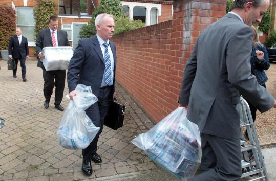 Police officers removed documents from the home of former News of the World editor Andy Coulson in London yesterday.