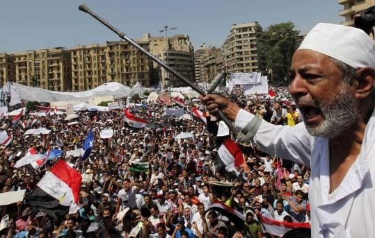 """A protester shouted out against the former regime yesterday in Tahrir Square. The """"Friday of determination,'' was the largest demonstration since the revolt in January and February."""