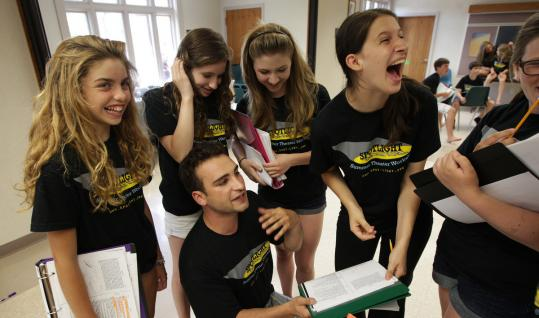 ESSDRAS M SUAREZ/GLOBE STAFF Harley Yanoff (sitting) directs young locals (from left: Anna Wells, Chloe Winston, Alana Speth, Emma Klapper, and Nora Dowd) during a Spotlight Summer Theater Workshop rehearsal in Weston.