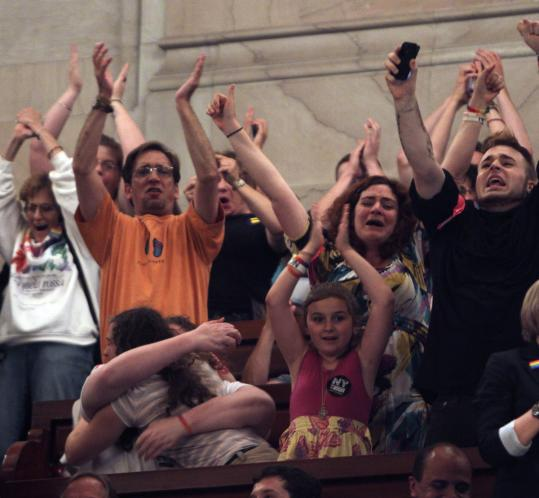 Observers in the New York Senate gallery react to the passage of gay marriage June 24.
