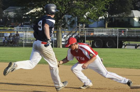 Sean Patrikas (9) of Danvers is out at first as Newburyport Post 150&#8217;s Ryan O&#8217;Connor makes the catch during a game last week.