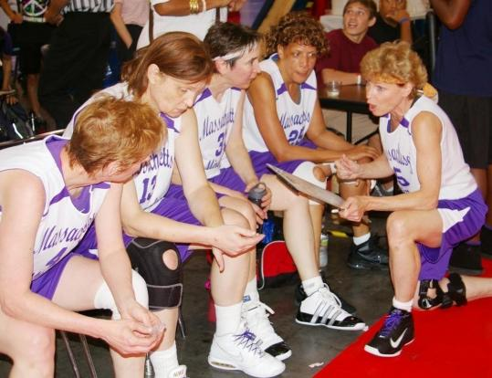 Winchester's Tina Quick (right) talks to her teammates on the sidelines during the National Senior Games in Houston.