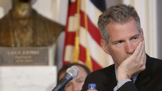 Senator Scott Brown has been the target of Democrats who created an online clock to call for town hall events. A spokeswoman said he interacts with the public in other ways.
